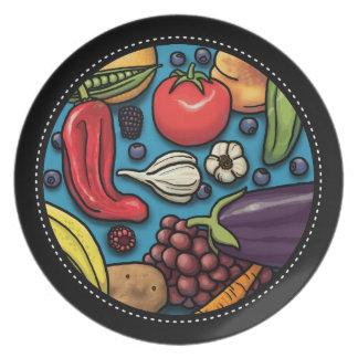 Frutas y verduras coloridas en azul plato