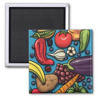 Frutas y verduras coloridas en el imán azul