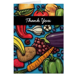 Frutas y verduras coloridas en tarjeta azul