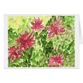 Fuchsia flowers against green grass post card