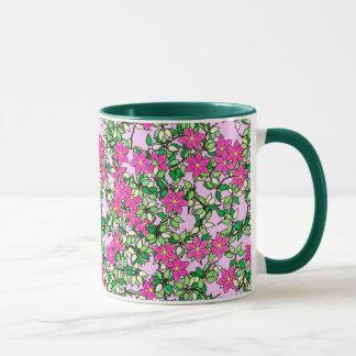 Fucshia flowers on a pale pink background mug
