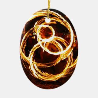 Fuego de giro - extracto adorno navideño ovalado de cerámica