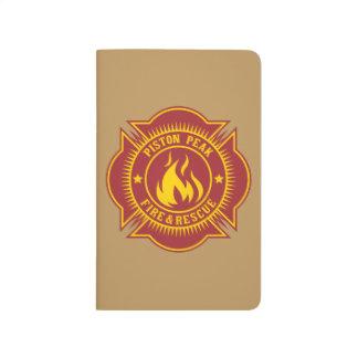 Fuego del pistón y insignia máximos del rescate cuadernos