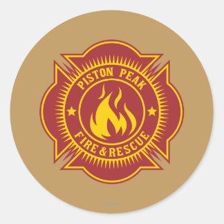 Fuego del pistón y insignia máximos del rescate pegatinas redondas
