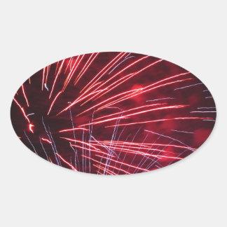 Fuegos artificiales coloridos de diversos colores pegatina ovalada