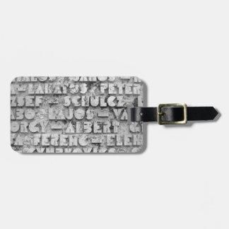 Fuente de piedra secreta etiqueta para maleta