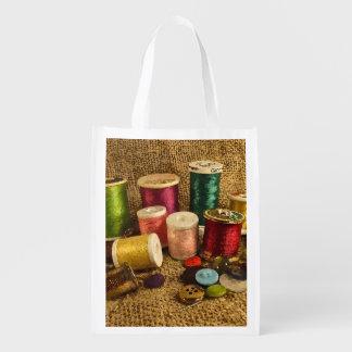 Fuentes de costura bolsas de la compra