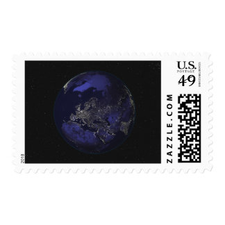 Full Earth at night showing city lights 3 Stamps