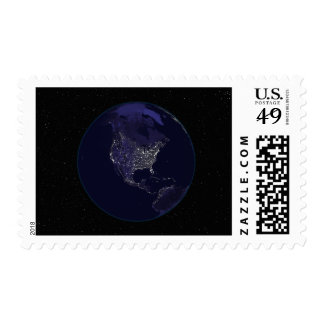 Full Earth at night showing city lights 4 Stamps