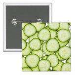 Full frame of sliced cucumber, on white 2 inch square button