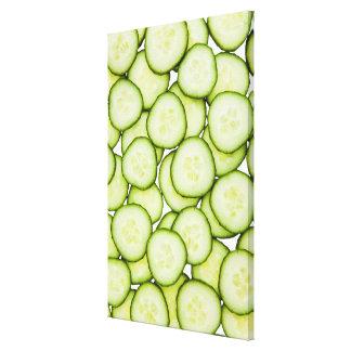 Full frame of sliced cucumber, on white canvas print