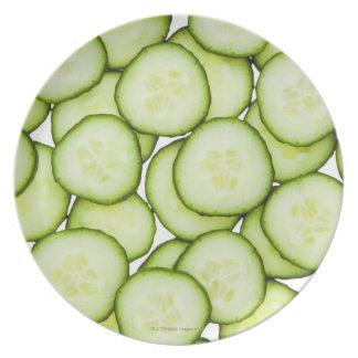 Full frame of sliced cucumber, on white melamine plate