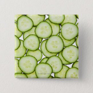 Full frame of sliced cucumber, on white pinback button