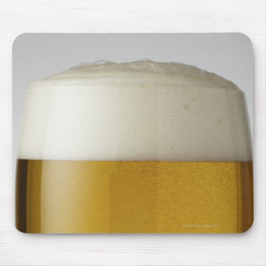 Full glass of beer indoors mouse pad