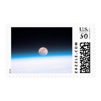 Full moon partially obscured by atmosphere postage