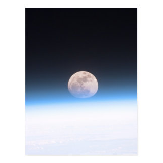 Full moon partially obscured by atmosphere postcard