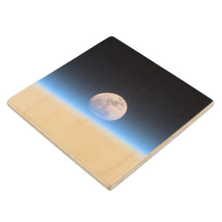 Full moon partially obscured by atmosphere wood coaster