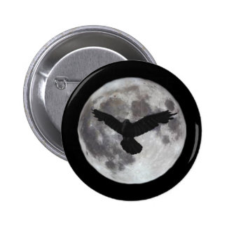 Full moon with crow flying in front of it pinback button