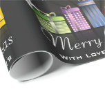 "Fun & Festive Personalized Merry Christmas Wrapping Paper<br><div class=""desc"">Add a special touch to your gift giving with personalized wrapping paper.  Colorfully wrapped gifts with the the message,  ""Merry Christmas"" add your family's name.</div>"