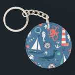 "Fun Nautical Graphic Pattern Keychain<br><div class=""desc"">This fab design features a nautical theme with tons of sea life,  lighthouses,  whales,  anchors &amp; nautical flags on a dark blue background</div>"