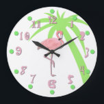 "Fun Pink Flamingo Wall Clock<br><div class=""desc"">Whimsical tropical wall clock done with a white background and graphics of a pink flamingo,  in the middle,  and a green palm tree silhouette off to the side.  Fun pink numbers and green dots finish off this great clock.  Customize to add any text you want.</div>"
