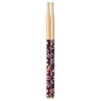 Fun purple skulls and bows pattern drum sticks