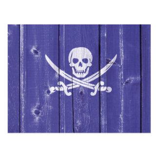 Fun skull cross swords on blue wood panel printed postcard