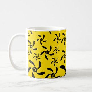 Fun sunny yellow and black flower design. mugs