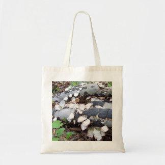 Fungi on fallen tree budget tote bag