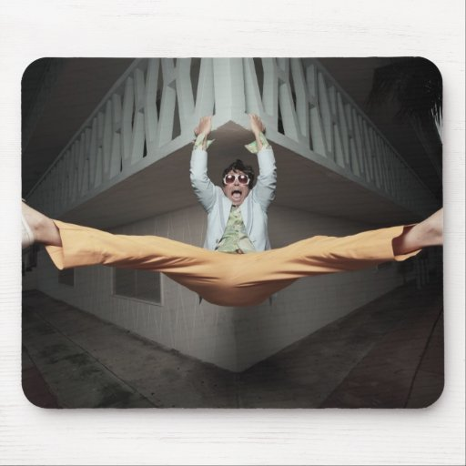 Funky Man hanging from a ledge Mouse Pad