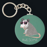 "Funny Awesome Possum Keychain<br><div class=""desc"">This cartoon opossum is so awesome with his little pink sunglasses. Hilarious.</div>"