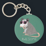 """Funny Awesome Possum Keychain<br><div class=""""desc"""">This cartoon opossum is so awesome with his little pink sunglasses. Hilarious.</div>"""