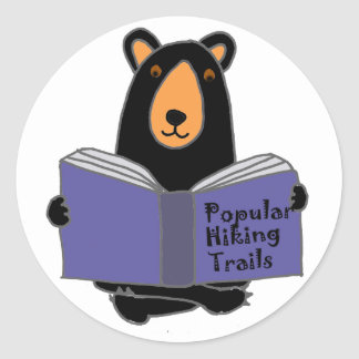 Funny Black Bear Reading about Hiking Trails Classic Round Sticker