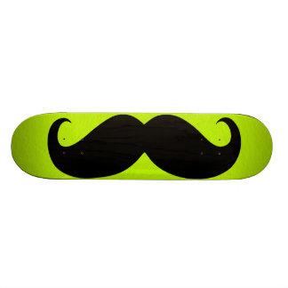 Funny black mustache on green background skateboard