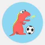 Funny Cartoon Dinosaur Playing Soccer Classic Round Sticker