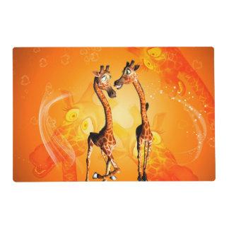 Funny cartoon giraffes laminated place mat