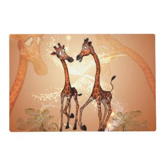 Funny cartoon giraffes laminated placemat