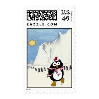 Funny Christmas penguin dancing in the Antarctic. Stamp