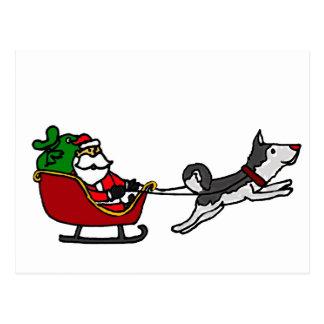 Funny Christmas Sleigh with Husky Dog Pulling Postcard