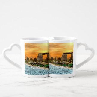 Funny dinosaur running on the beach coffee mug set