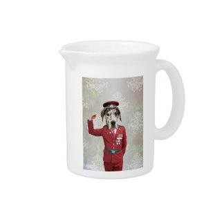 Funny dog in red uniform drink pitcher
