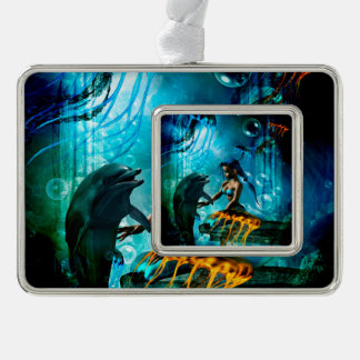 Funny dolphin playing with cute mermaid christmas ornament
