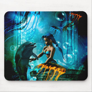 Funny dolphin playing with cute mermaid mouse pad