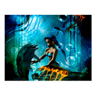 Funny dolphin playing with cute mermaid postcard