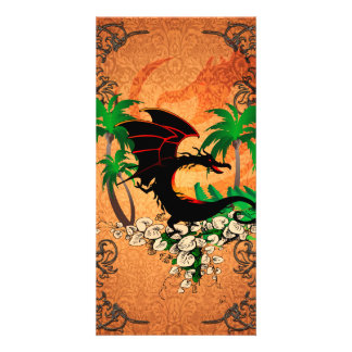Funny dragon with palm and flowers photo card