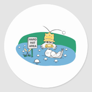 funny duck with hard hat avoiding golf balls classic round sticker
