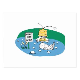 funny duck with hard hat avoiding golf balls postcard