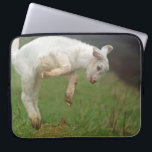 """Funny Goat Baby White Goat Jumping in Pasture Laptop Sleeve<br><div class=""""desc"""">Baby goat jumping for joy in a green pasture.  This lovely goat is playfully jumping high in a grassy Oregon pasture.  Young goats at play are about the cutest animals on Earth.  Leaping goat youngsters are fun animals to see being joyfull in the barnyard.</div>"""