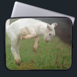 "Funny Goat Baby White Goat Jumping in Pasture Laptop Sleeve<br><div class=""desc"">Baby goat jumping for joy in a green pasture.  This lovely goat is playfully jumping high in a grassy Oregon pasture.  Young goats at play are about the cutest animals on Earth.  Leaping goat youngsters are fun animals to see being joyfull in the barnyard.</div>"