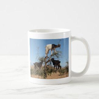 Funny goats in a tree basic white mug
